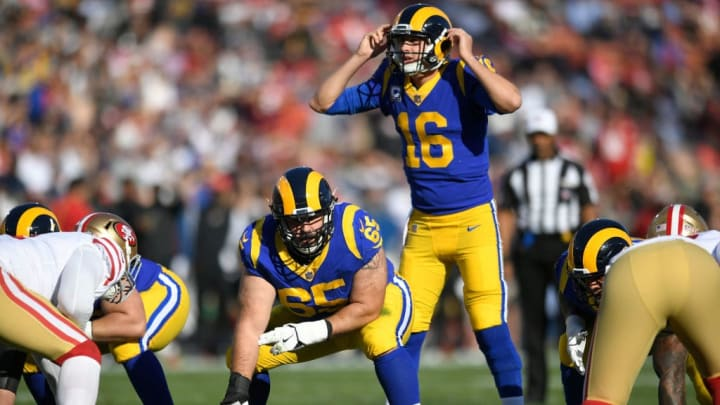 LOS ANGELES, CA - DECEMBER 30: John Sullivan #65 gets ready to snap the ball to Jared Goff #16 of the Los Angeles Rams against the San Francisco 49ers at Los Angeles Memorial Coliseum on December 30, 2018 in Los Angeles, California. Rams won 48-32. (Photo by John McCoy/Getty Images)