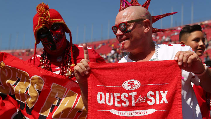 LOS ANGELES, CALIFORNIA - OCTOBER 13: Fans root for their team during warmup at the San Francisco 49ers v Los Angeles Rams Game at Los Angeles Memorial Coliseum on October 13, 2019 in Los Angeles, California. (Photo by Joe Scarnici/Getty Images)