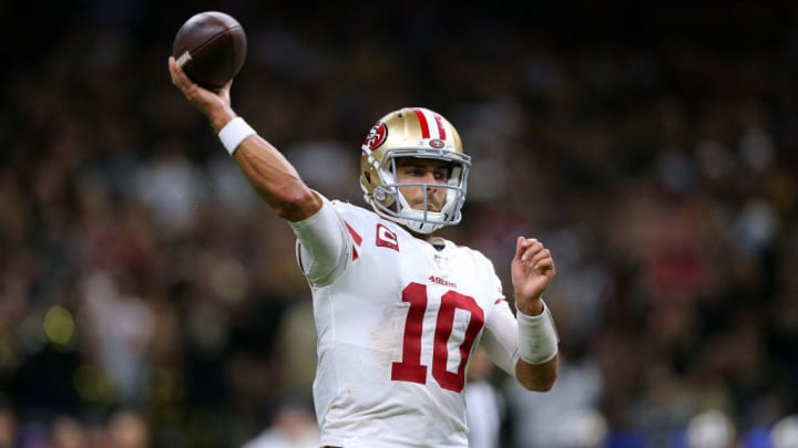 Jimmy Garoppolo attempts a pass against the New Orleans Saints in a Week 14 game.