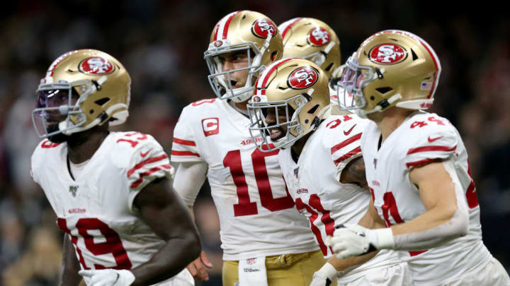 Jimmy Garoppolo, Kyle Juszczyk & Raheem Mostert celebrate in a game against the New Orleans Saints.