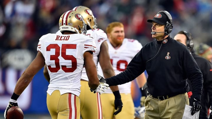 EAST RUTHERFORD, NJ - NOVEMBER 16:   Eric Reid #35 of the San Francisco 49ers is greeted by head coach Jim Harbaugh after an interception against the New York Giants at MetLife Stadium on November 16, 2014 in East Rutherford, New Jersey.  (Photo by Al Bello/Getty Images)