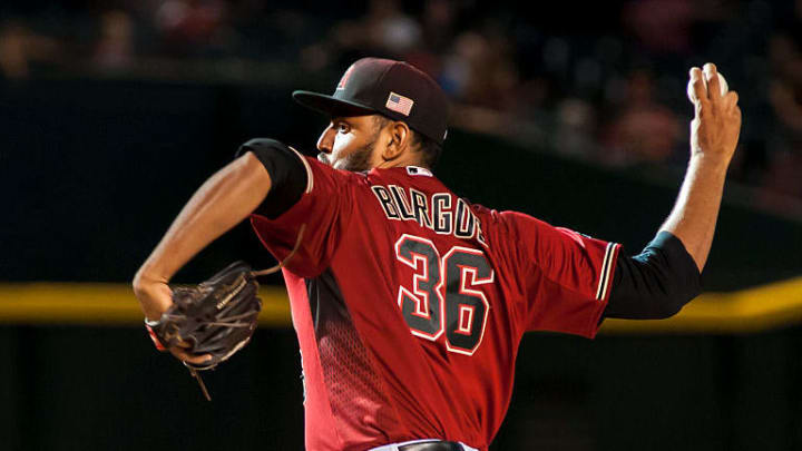 PHOENIX, AZ - SEPTEMBER 11: Relief pitcher Enrique Burgos #36 of the Arizona Diamondbacks throws a pitch in the ninth inning of the MLB game against the San Francisco Giants at Chase Field on September 11, 2016 in Phoenix, Arizona. The San Francisco Giants defeated the Arizona Diamondbacks 5-3. (Photo by Darin Wallentine/Getty Images)
