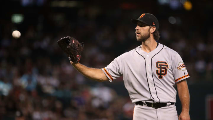 PHOENIX, ARIZONA - AUGUST 18:  Starting pitcher Madison Bumgarner #40 of the San Francisco Giants catches a throw back during the third inning of the MLB game against the Arizona Diamondbacks at Chase Field on August 18, 2019 in Phoenix, Arizona. (Photo by Christian Petersen/Getty Images)