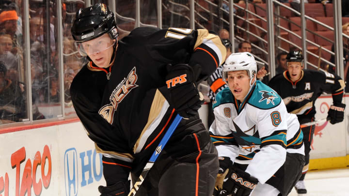 ANAHEIM, CA - OCTOBER 17:  Corey Perry #10 of the Anaheim Ducks gets the puck off the boards in front of Joe Pavelski #8 of the San Jose Sharks during the first period at the Honda Center on October 17, 2008 in Anaheim, California.  (Photo by Harry How/Getty Images)