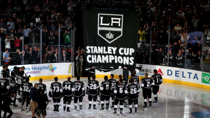LOS ANGELES, CA - OCTOBER 08:  The Los Angeles Kings stands on the ice as the Stanley Cup Championship banner is unfurled during ceremonies before the game with the San Jose Sharks in their NHL season opener at Staples Center on October 8, 2014 in Los Angeles, California.  (Photo by Stephen Dunn/Getty Images)
