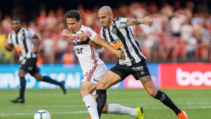 Hernanes, Fabio Santos