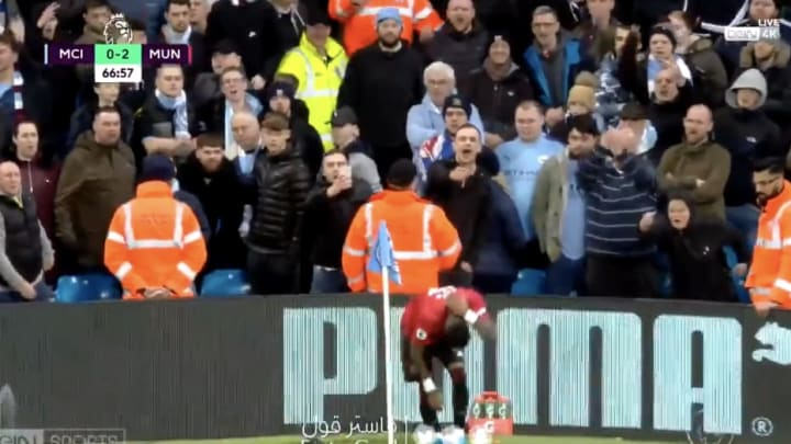 Manchester United midfielder Fred covers his head as he's pelted by opposing fans.