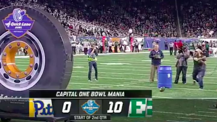 A fan at the Quick Lane Bowl in Detroit showed off his sidearm abilities. They weren't great.