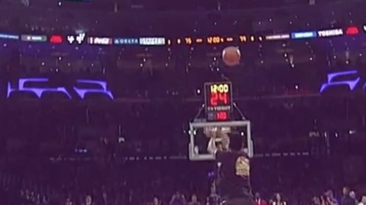 An incredible shot from a Los Angeles Lakers fan which netted him $100,000.