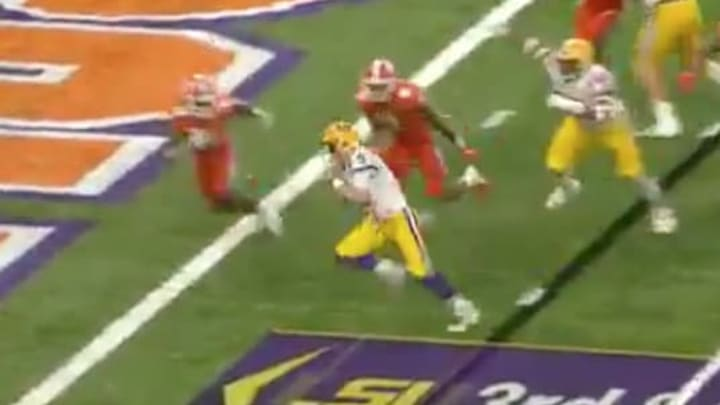 Joe Burrow dodges a few Clemson defenders on his way to the endzone