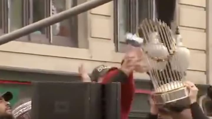 A local Boston genius breaking the Red Sox World Series trophy and cursing them for 86 more years