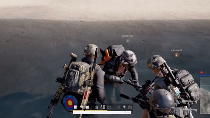 A PUBG team works together to save their teammate who has lagged out or crashed and is stuck running
