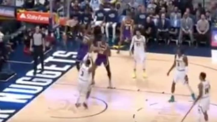 Los Angeles Lakers star LeBron James posterizes Denver Nuggets forward Torrey Craig