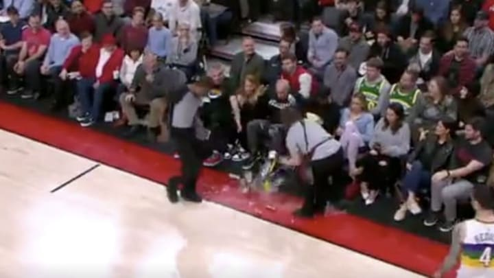 NBA referee Mitchell Ervin bumps into woman with drink tray