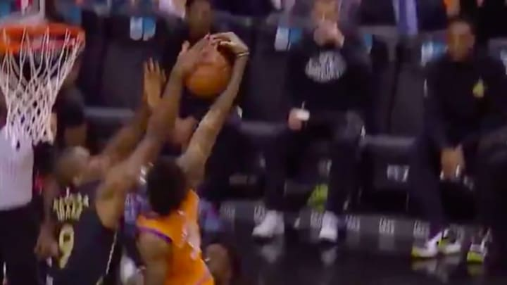 Toronto Raptors' Serge Ibaka blocks Phoenix Suns' Kelly Oubre Jr.