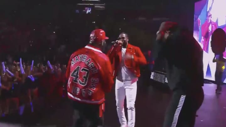 Dwayne Wade and Rick Ross on stage performing Season Ticket Holder.