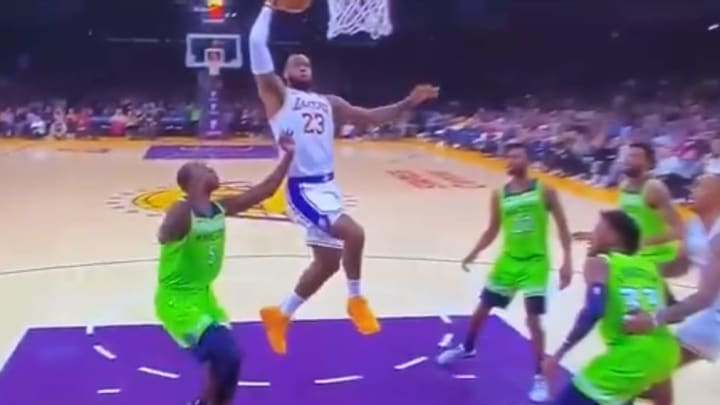 LeBron James posterizes Gorgui Deng during Sunday's Lakers-Timberwolves game.