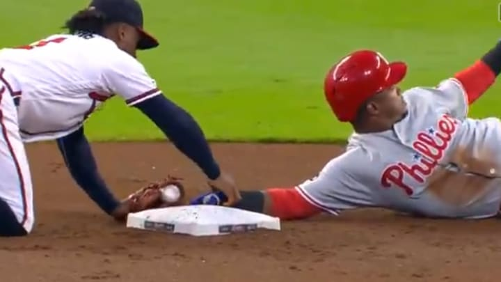 Ozzie Albies takes Jean Segura's hand off bag after stolen base on Wednesday.