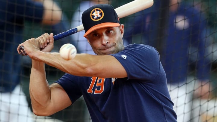 HOUSTON, TEXAS - AUGUST 03: Bench coach Joe Espada #19 hits balls during batting practice to infielders before a game against the Seattle Mariners at Minute Maid Park on August 03, 2019 in Houston, Texas. (Photo by Bob Levey/Getty Images)