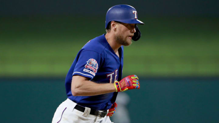 ARLINGTON, TEXAS - MAY 20: Hunter Pence #24 of the Texas Rangers rounds the bases after hitting a two-run home run against the Seattle Mariners in the bottom of the seventh inning at Globe Life Park in Arlington on May 20, 2019 in Arlington, Texas. (Photo by Tom Pennington/Getty Images)