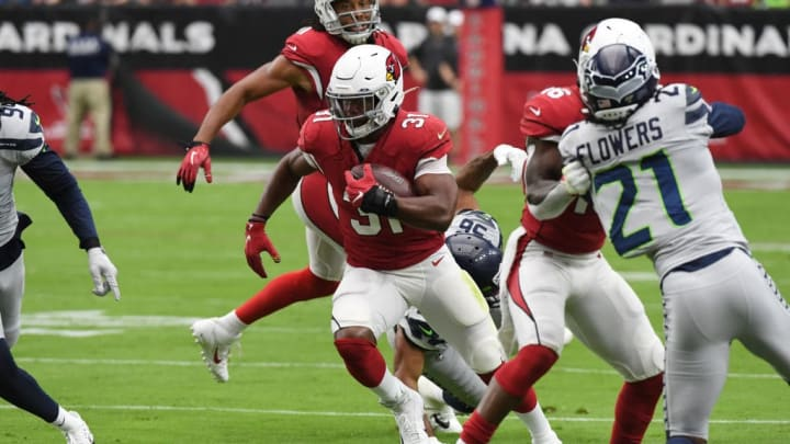 GLENDALE, ARIZONA - SEPTEMBER 29: David Johnson #31 of the Arizona Cardinals runs with the ball during a game against the Seattle Seahawks at State Farm Stadium on September 29, 2019 in Glendale, Arizona. (Photo by Norm Hall/Getty Images)