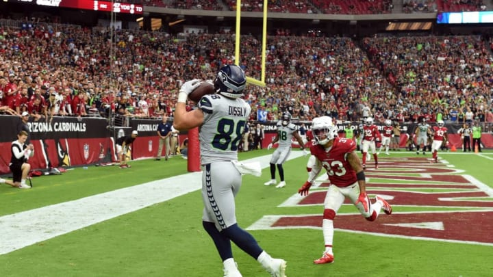 GLENDALE, ARIZONA - SEPTEMBER 29: Will Dissly #88 of the Seattle Seahawks catches a first half touchdown from Russell Wilson #3 while being defended by Byron Murphy Jr #33 of the Arizona Cardinals at State Farm Stadium on September 29, 2019 in Glendale, Arizona. (Photo by Norm Hall/Getty Images)