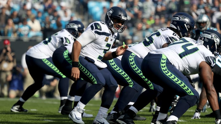 CHARLOTTE, NC - NOVEMBER 25:  Russell Wilson #3 of the Seattle Seahawks makes a call at the line against the Carolina Panthers in the first quarter during their game at Bank of America Stadium on November 25, 2018 in Charlotte, North Carolina.  (Photo by Streeter Lecka/Getty Images)