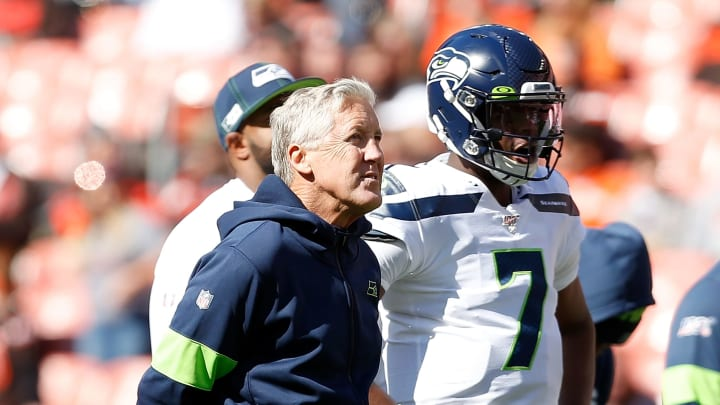 CLEVELAND, OH - OCTOBER 13:  Head Coach Pete Carroll of the Seattle Seahawks stands on the field with Geno Smith #7 prior to the start of the game against the Cleveland Browns at FirstEnergy Stadium on October 13, 2019 in Cleveland, Ohio. Seattle defeated Cleveland 32-28. (Photo by Kirk Irwin/Getty Images)