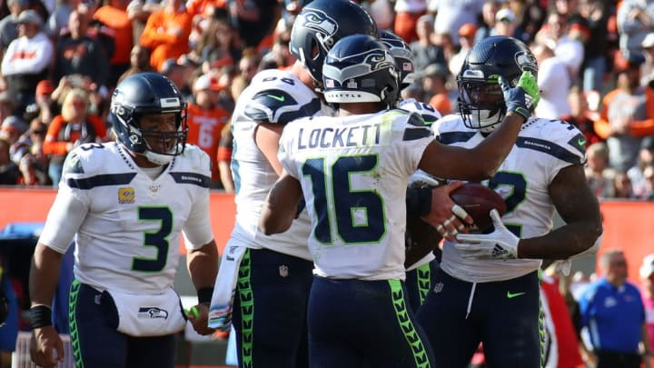 CLEVELAND, OHIO - OCTOBER 13: Chris Carson #32 of the Seattle Seahawks celebrates his fourth quarter touchdown with Tyler Lockett #16, Justin Britt #68 and Russell Wilson #3 while playing the Cleveland Browns at FirstEnergy Stadium on October 13, 2019 in Cleveland, Ohio. Seattle win the game 32-28. (Photo by Gregory Shamus/Getty Images)