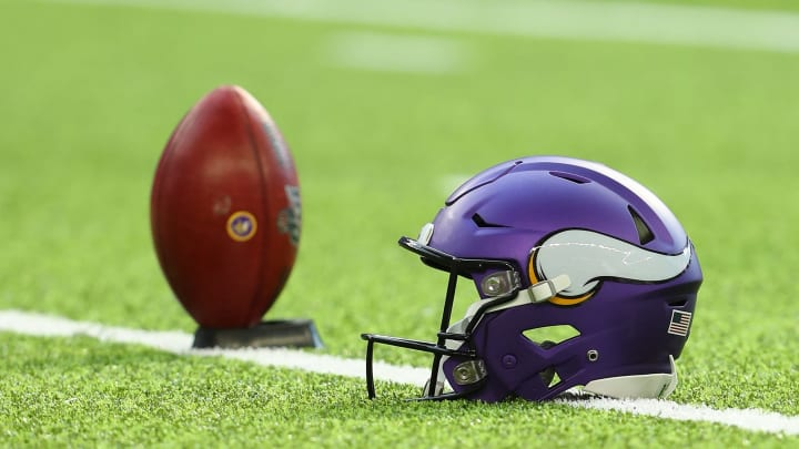 MINNEAPOLIS, MN - AUGUST 18: A Minnesota Vikings helmet and ball on the field before the pre-season game against the Seattle Seahawks at U.S. Bank Stadium on August 18, 2019 in Minneapolis, Minnesota. (Photo by Adam Bettcher/Getty Images)