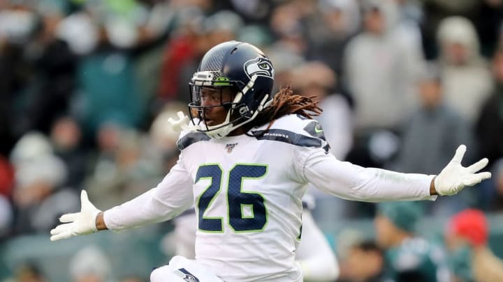 PHILADELPHIA, PENNSYLVANIA - NOVEMBER 24:  Shaquill Griffin #26 of the Seattle Seahawks celebrates after the Eagles are unable to get the first down at Lincoln Financial Field on November 24, 2019 in Philadelphia, Pennsylvania.The Seattle Seahawks defeated the Philadelphia Eagles 17-9. (Photo by Elsa/Getty Images)