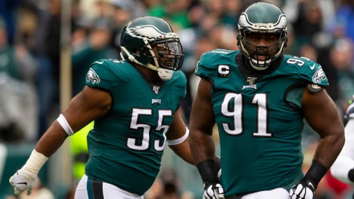Fletcher Cox and Brandon Graham prepare for another play in a game against the Seattle Seahawks.