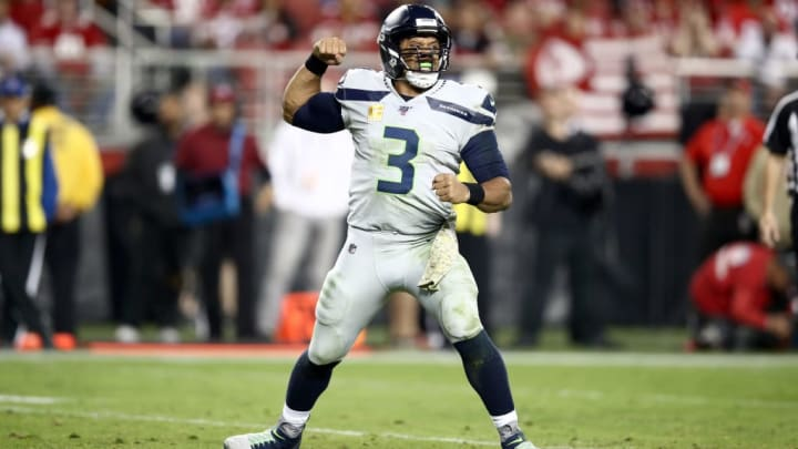 SANTA CLARA, CALIFORNIA - NOVEMBER 11: Quarterback Russell Wilson #3 of the Seattle Seahawks celebrates the touchdown by running back Chris Carson #32 in the third quarter against the San Francisco 49ers at Levi's Stadium on November 11, 2019 in Santa Clara, California.  Photo by Ezra Shaw/Getty Images)