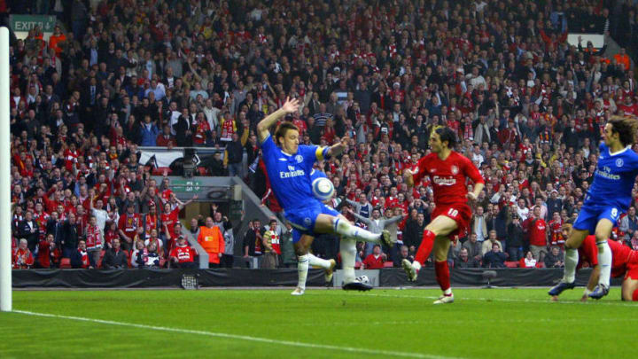 Liverpool's Luis Garcia pokes the ball beyond Chelsea's John Terry