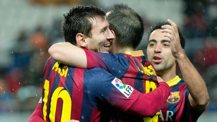 Messi (left), Iniesta (centre) and Xavi (right) celebrating a goal against Sevilla
