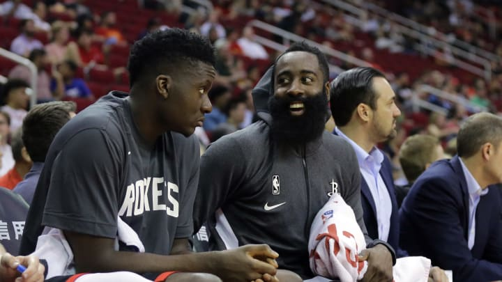 HOUSTON, TEXAS - SEPTEMBER 30: James Harden #13 of the Houston Rockets talks with Clint Capela #15 on the bench during the first quarter against the Shanghai Sharks at Toyota Center on September 30, 2019 in Houston, Texas. NOTE TO USER: User expressly acknowledges and agrees that, by downloading and/or using this photograph, user is consenting to the terms and conditions of the Getty Images License Agreement.  (Photo by Bob Levey/Getty Images)