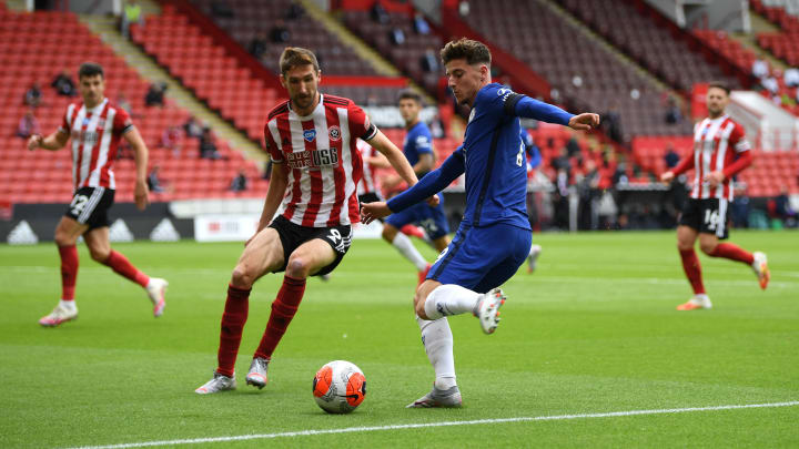Mason Mount takes on Sheffield United defender Chris Basham during his side's 3-0 defeat at Bramall Lane in July