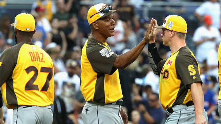 SAN DIEGO, CA - JULY 10:  World Team manager Moises Alou (C) high fives Tyler O'Neill #4 after defeating the U.S. Team 11-3 in the SiriusXM All-Star Futures Game at PETCO Park on July 10, 2016 in San Diego, California.  (Photo by Sean M. Haffey/Getty Images)