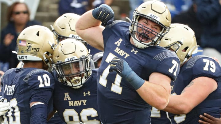 ANNAPOLIS, MARYLAND - OCTOBER 19: Wide receiver OJ Davis #86 of the Navy Midshipmen celebrates with teammates after scoring a touchdown against the South Florida Bulls during the second quarter at Navy-Marine Corps Memorial Stadium on October 19, 2019 in Annapolis, Maryland. (Photo by Patrick Smith/Getty Images)