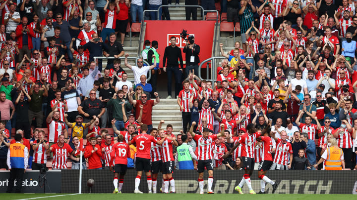 Southampton players celebrate with the fans after scoring against Manchester United