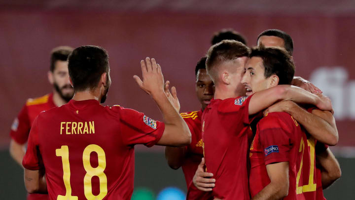 Spain players celebrate their opening goal against Switzerland