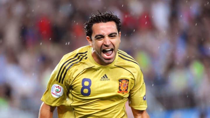 Spanish midfielder Xavi Hernandez celebr
