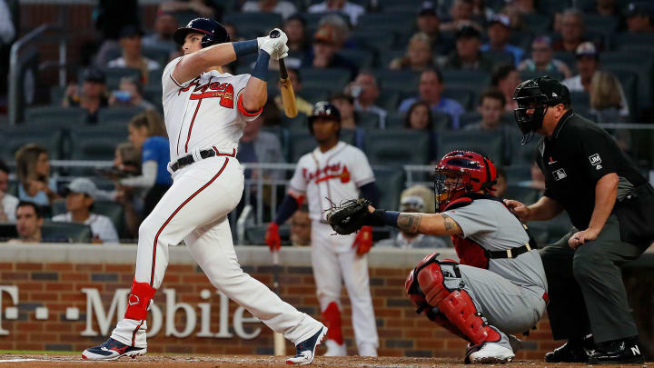 ATLANTA, GEORGIA - MAY 15:  Austin Riley #27 of the Atlanta Braves hits his first Major League home run in the fourth inning during his MLB debut against the St. Louis Cardinals at SunTrust Park on May 15, 2019 in Atlanta, Georgia. (Photo by Kevin C. Cox/Getty Images)