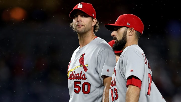 NEW YORK, NY - APRIL 16:  Adam Wainwright #50 of the St. Louis Cardinals is consoled by teammate Matt Carpenter #13 in the fifth inning against the New York Yankees on April 16, 2017 at Yankee Stadium in the Bronx borough of New York City.  (Photo by Elsa/Getty Images)