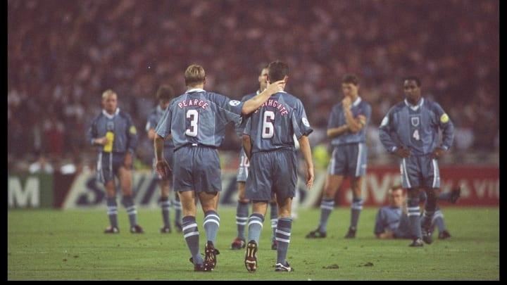 Stuart Pearce (left) consoles teammate Gareth Southgate