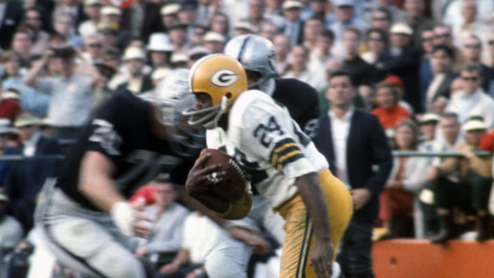 Former USC football quarterback Willie Wood with the Packers.