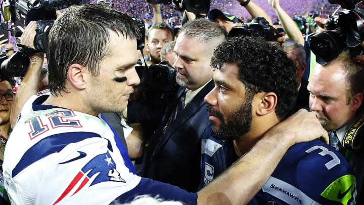 GLENDALE, AZ - FEBRUARY 01:   Tom Brady #12 of the New England Patriots is congratulated by  Russell Wilson #3 of the Seattle Seahawks after Super Bowl XLIX at University of Phoenix Stadium on February 1, 2015 in Glendale, Arizona. The Patriots defeated the Seahawks 28-24.     (Photo by Tom Pennington/Getty Images)