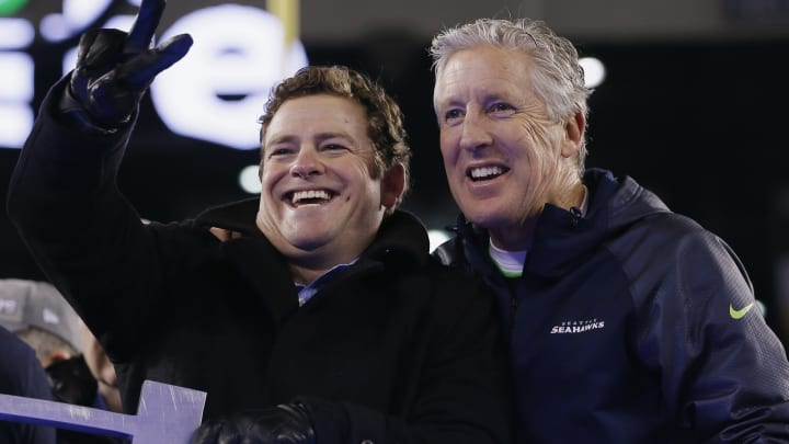 EAST RUTHERFORD, NJ - FEBRUARY 02:  (L-R) John Schneider, General Manager of the Seattle Seahawks and head coach Pete Carroll celebrates after their 43-8 victory over the Denver Broncos during Super Bowl XLVIII at MetLife Stadium on February 2, 2014 in East Rutherford, New Jersey.  (Photo by Kevin C. Cox/Getty Images)