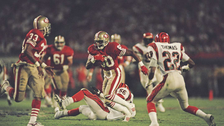 Jerry Rice #80, Wide Receiver for the San Francisco 49ers runs the ball during the National Football League Super Bowl XVIII game against the Cincinnati Bengals on 22 January 1989 at the Joe Robbie Stadium, Miami, Florida, United States. The 49ers won the game 20 - 16.  (Photo by Rick Stewart/Allsport/Getty Images)