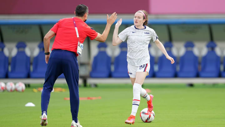 Rose Lavelle with head coach Vlatko Andonovski during the match against Sweden in the Tokyo Olympics